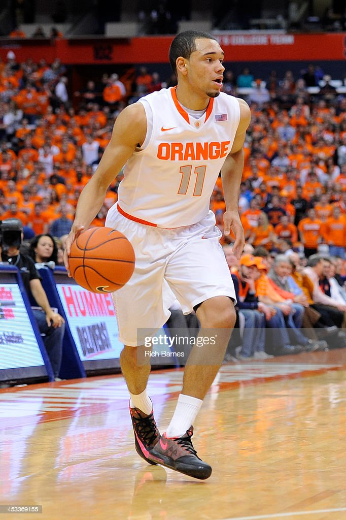 Tyler Ennis #11 of the Syracuse Orange drives to the basket against the Indiana Hoosiers during the first half at the Carrier Dome on December 3, 2013 in Syracuse, New York. Syracuse defeated Indiana 69-52.
