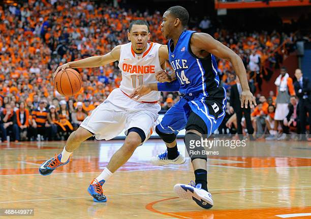 Tyler Ennis of the Syracuse Orange drives to the basket against the defense of Rasheed Sulaimon of the Duke Blue Devils during the first half at the...