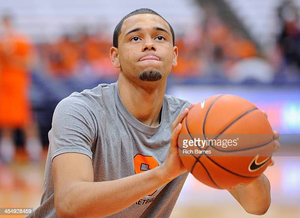 Tyler Ennis of the Syracuse Orange prepares to takes a shot prior to the game against the Indiana Hoosiers at the Carrier Dome on December 3 2013 in...