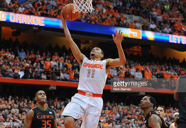 Tyler Ennis of the Syracuse Orange takes a shot over James Kelly of the Miami Hurricanes during the second half at the Carrier Dome on January 4 2014...