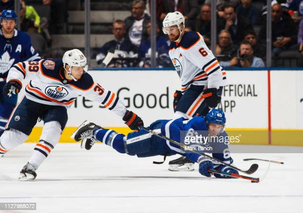 Tyler Ennis of the Toronto Maple Leafs battles for the puck against Alex Chiasson of the Edmonton Oilers during the third period at the Scotiabank...