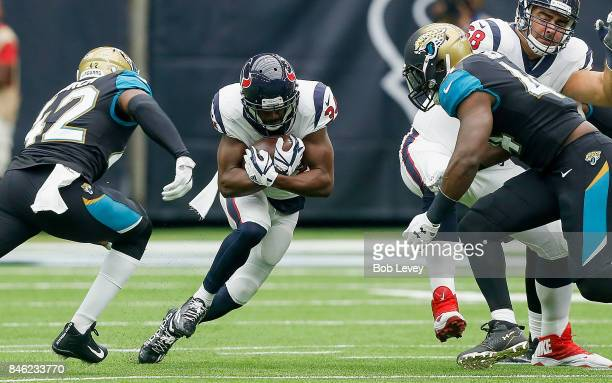 Tyler Ervin of the Houston Texans returns a punt as Breno Giacomini prepares to block Myles Jack of the Jacksonville Jaguars and Barry Church at NRG...