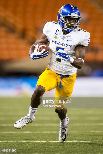 Tyler Ervin of the San Jose State Spartans carries the ball against the Hawaii Warriors during the first quarter of a college football game at Aloha...