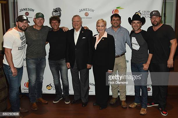 Tyler Farr Ben Hayslip Billy Currington Georgia Governor Nathan Deal and wife Sandra Dunagan Rhett Akins Craig Campbell and Dallas Davidson backstage...