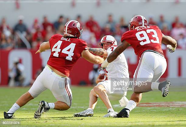 Tyler Ferguson of the Western Kentucky Hilltoppers prepares to be sacked by Dakota Ball and Jonathan Allen of the Alabama Crimson Tide at BryantDenny...
