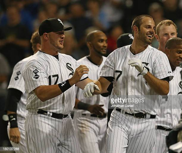 Tyler Flowers and Jordan Danks of the Chicago White Sox celebrate Dank's first Major League home run a walkoff solo shot with two out in the 9th...