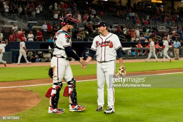 Tyler Flowers and Luke Jackson of the Atlanta Braves celebrate after the game against the Philadelphia Phillies at SunTrust Park on June 7 2017 in...