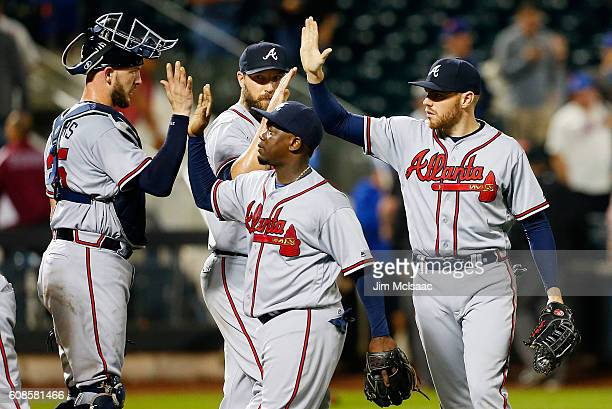 Tyler Flowers Jim Johnson Adonis Garcia and Freddie Freeman of the Atlanta Braves celebrate after defeating the New York Mets at Citi Field on...