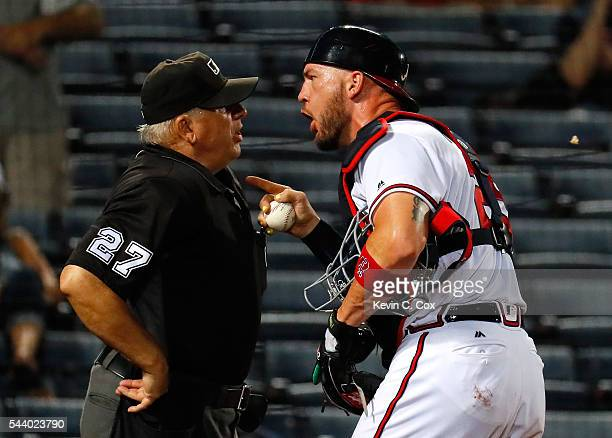 Tyler Flowers of the Atlanta Braves argues with homeplate umpire Larry Vanover during the third inning immediately after he was tossed out of the...
