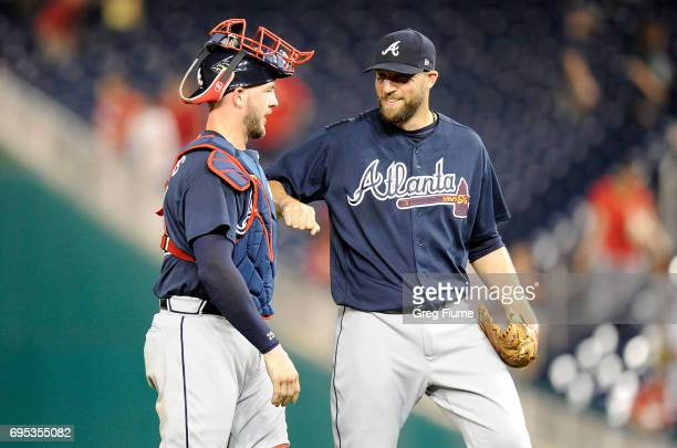 Tyler Flowers of the Atlanta Braves celebrates with Jim Johnson after a 1110 victory against the Washington Nationals at Nationals Park on June 12...