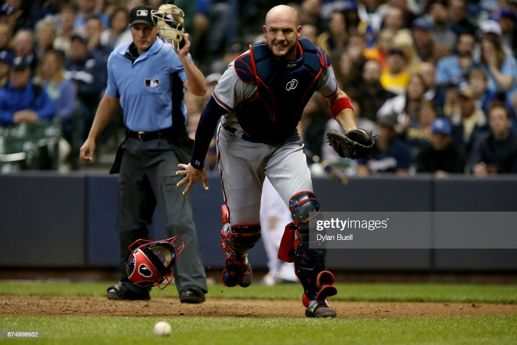 Tyler Flowers #25 of the Atlanta Braves chases after a wild pitch in the fifth inning against the Milwaukee Brewers at Miller Park on April 29, 2017 in Milwaukee, Wisconsin.