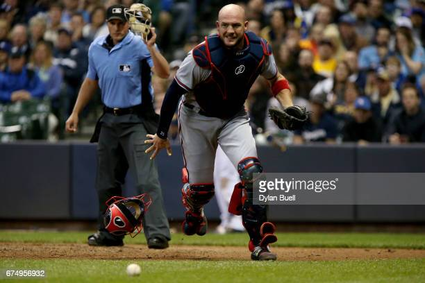Tyler Flowers of the Atlanta Braves chases after a wild pitch in the fifth inning against the Milwaukee Brewers at Miller Park on April 29 2017 in...