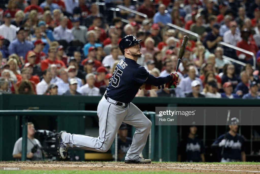 Tyler Flowers #25 of the Atlanta Braves follows his RBI double against the Washington Nationals in the sixth inning at Nationals Park on September 13, 2017 in Washington, DC.