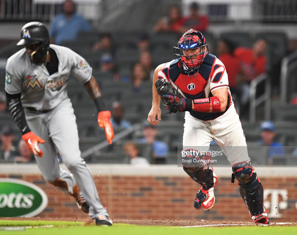 Tyler Flowers #25 of the Atlanta Braves gets Cameron Maybin #1 of the Miami Marlins in a seventh inning run-down at SunTrust Park on July 30, 2018 in Atlanta, Georgia.