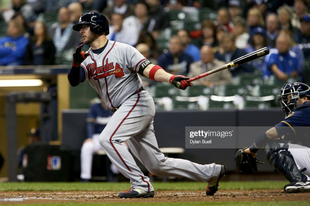 Tyler Flowers #25 of the Atlanta Braves hits a single in the fourth inning against the Milwaukee Brewers at Miller Park on April 29, 2017 in Milwaukee, Wisconsin.