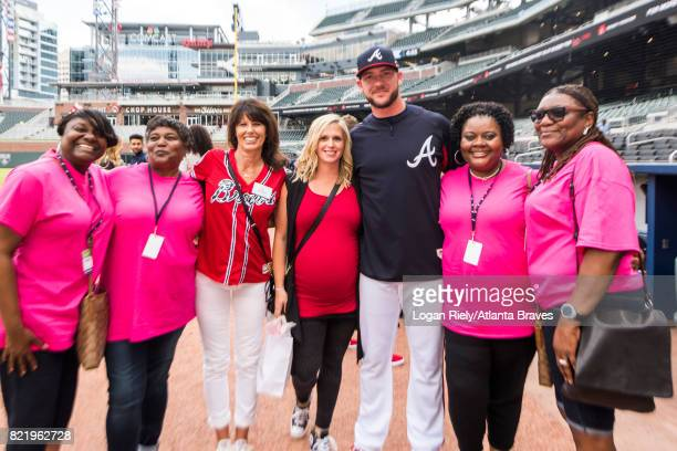 Tyler Flowers of the Atlanta Braves stands with the honorary bat girl before the game during batting practice against the Washington Nationals at...