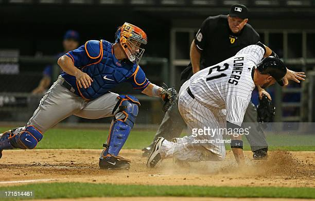 Tyler Flowers of the Chicago White Sox beats the tag of John Buck of the New York Metsto socre a run in the 5th inning at US Cellular Field on June...