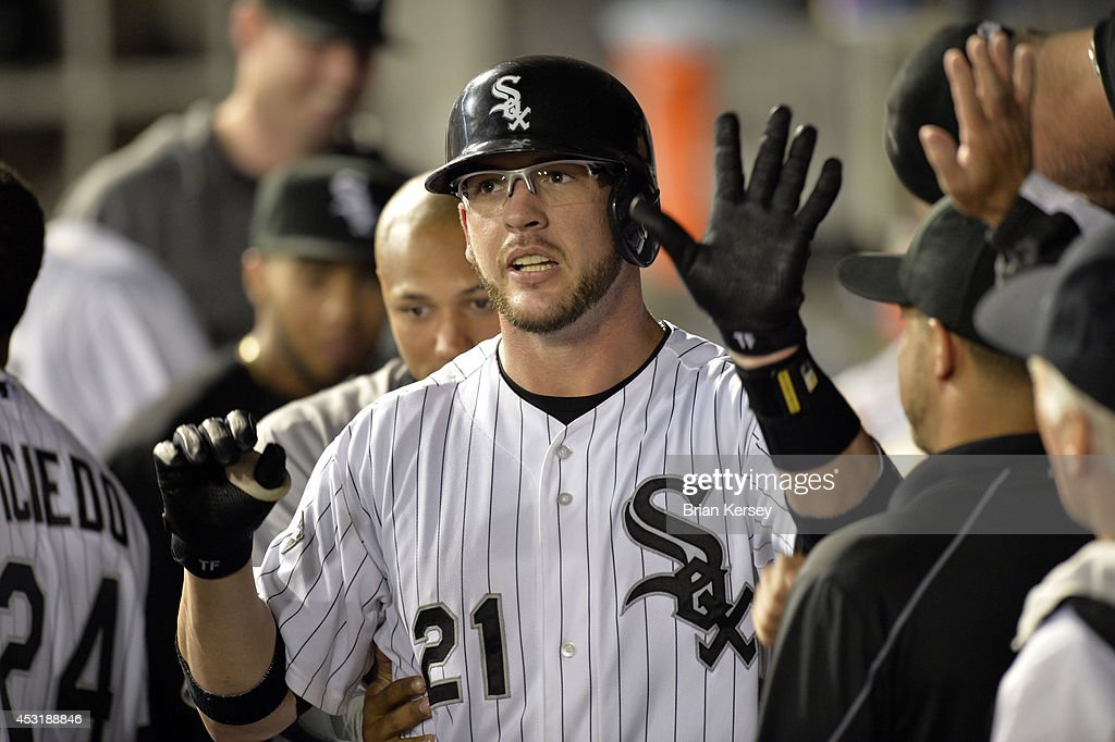 Tyler Flowers #21 of the Chicago White Sox is congratulated in the dugout after hitting a solo home run during the fifth inning against the Texas Rangers at U.S. Cellular Field on August 4, 2014 in Chicago, Illinois.