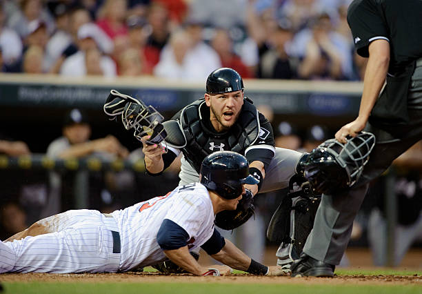 Chicago white sox v minnesota twins photos and images getty images tyler flowers 21 of the chicago white sox reacts as justin morneau 33 of mightylinksfo Choice Image