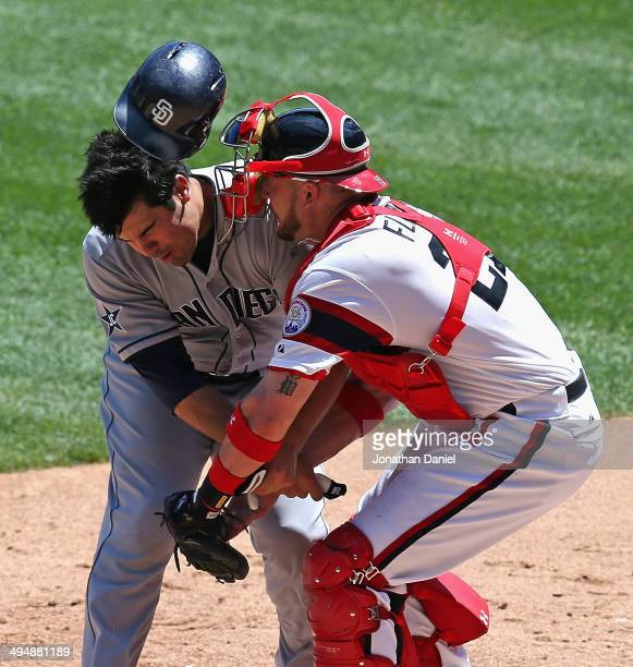 Tyler Flowers of the Chicago White Sox tags out Carlos Quentin of the San Diego Padres during a collison at the plate in the 3rd inning at US...