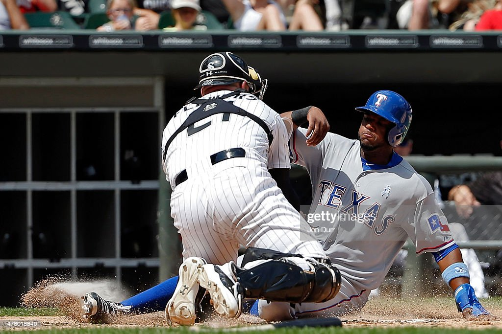 Tyler Flowers #21 of the Chicago White Sox tags out Hanser Alberto #68 of the Texas Rangers at home plate during the fifth inning at U.S. Cellular Field on June 21, 2015 in Chicago, Illinois.