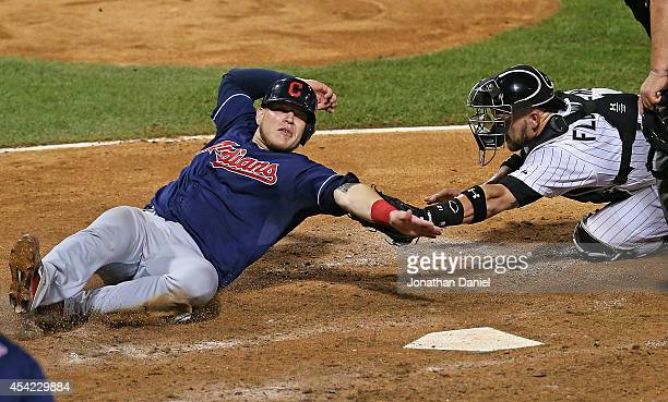 Tyler Flowers of the Chicago White Sox tags out Roberto Perez of the Cleveland Indians in the 6th inning at US Cellular Field on August 26 2014 in...