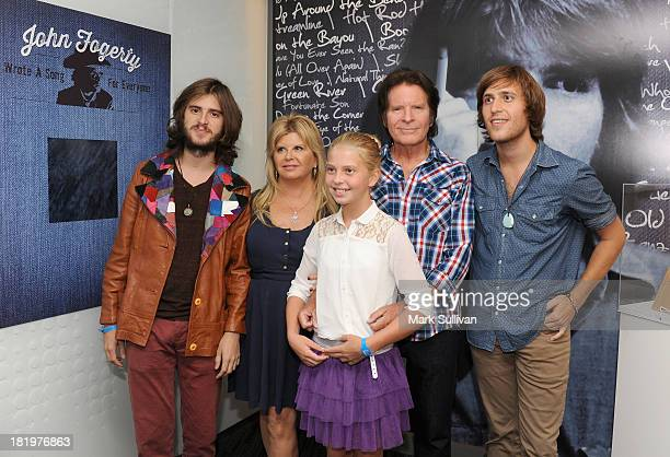 Tyler Fogerty Julie Fogerty Kelsy Fogerty John Fogerty and Shane Fogerty pose in the John Fogerty Wrote A Song For Everyone exhibit during a press...
