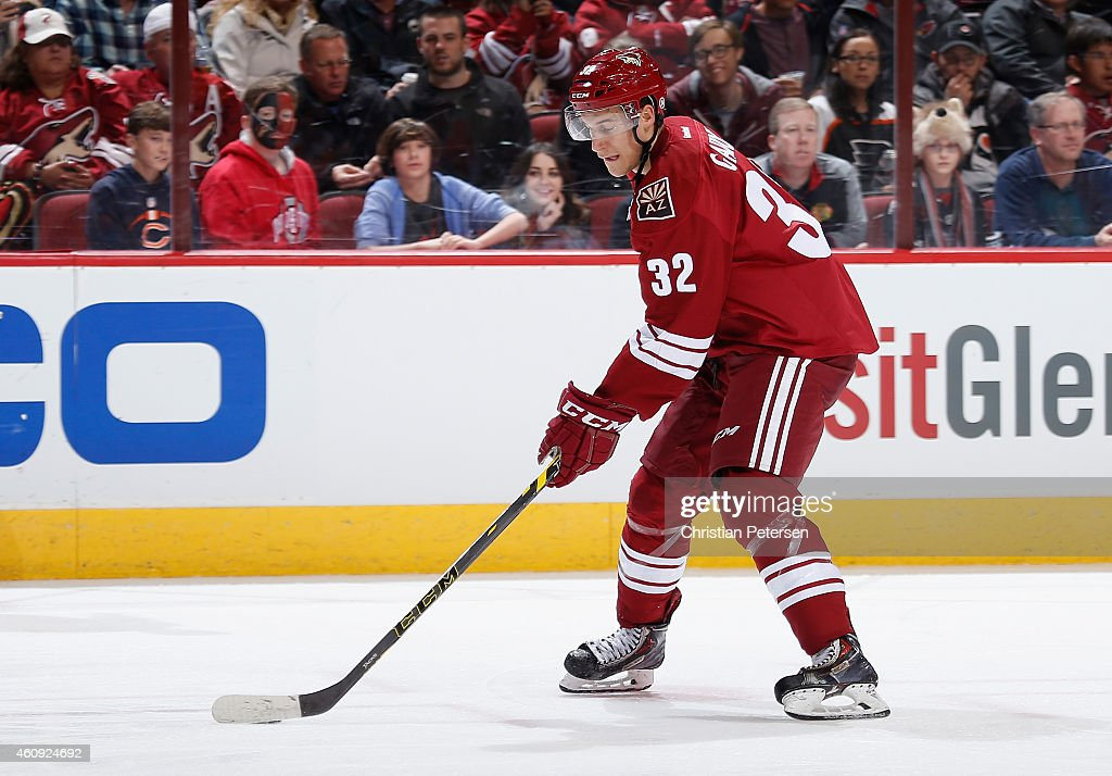 Tyler Gaudet #32 of the Arizona Coyotes skates with the puck during the NHL game against the Philadelphia Flyers at Gila River Arena on December 29, 2014 in Glendale, Arizona. The Coyotes defeated the Flyers 4-2.