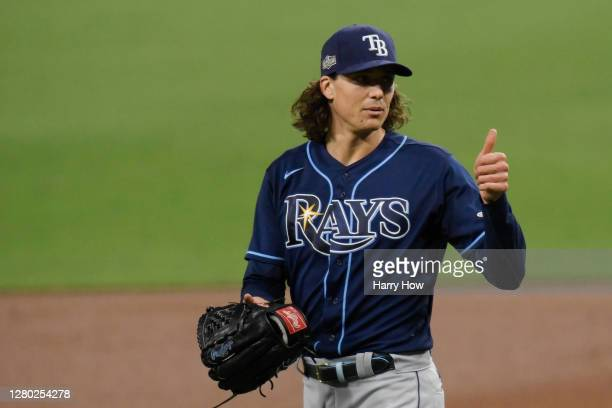 Tyler Glasnow of the Tampa Bay Rays gives a thumbs up after being hit by a line drive off the bat of Martin Maldonado of the Houston Astros during...
