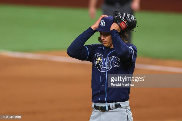 Tyler Glasnow of the Tampa Bay Rays reacts after allowing a two run home run to Cody Bellinger of the Los Angeles Dodgers during the fourth inning in...