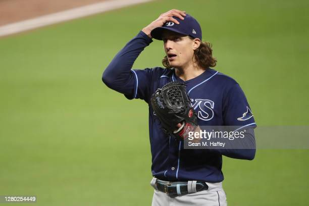Tyler Glasnow of the Tampa Bay Rays reacts as he walks off the field after giving up a run against the Houston Astros during the third inning in Game...