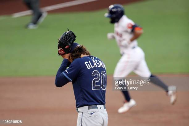 Tyler Glasnow of the Tampa Bay Rays reacts as Jose Altuve of the Houston Astros rounds the bases after hitting a solo home run during the first...