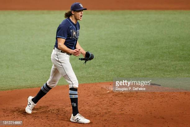 Tyler Glasnow of the Tampa Bay Rays reacts during the fourth inning against the Texas Rangers at Tropicana Field on April 12, 2021 in St Petersburg,...