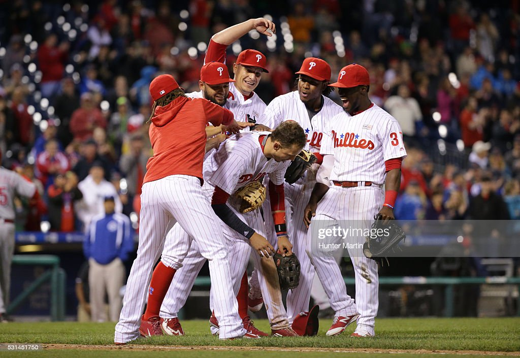 Tyler Goeddel #2 of the Philadelphia Phillies is swarmed by teammates after his game saving throw to home plate in the ninth inning during a game against the Cincinnati Reds at Citizens Bank Park on May 14, 2016 in Philadelphia, Pennsylvania. The Phillies won 4-3.