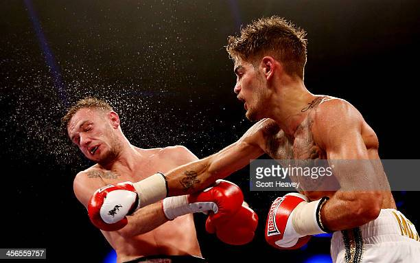 Tyler Goodjohn catches Danny Connor with a right hook during their English Light Welterweight Eliminator bout at ExCel on December 14 2013 in London...