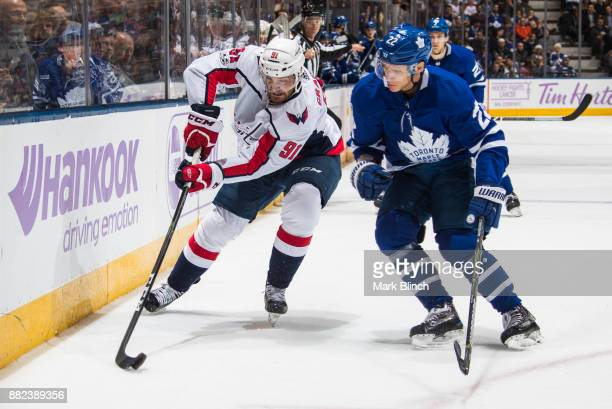 Tyler Graovac of the Washington Capitals skates against Nikita Zaitsev of the Toronto Maple Leafs during the second period at the Air Canada Centre...