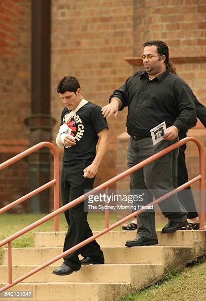 Tyler Green left leaves St Carthage's Cathedral in Lismore with his sister's boyfriend after the funeral of his friend Mitchell Eveleigh who was...