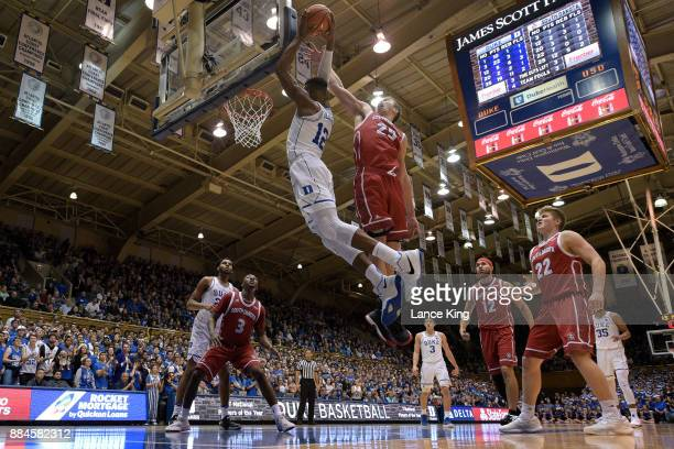Tyler Hagedorn of the South Dakota Coyotes defends a shot by Javin DeLaurier of the Duke Blue Devils at Cameron Indoor Stadium on December 2 2017 in...