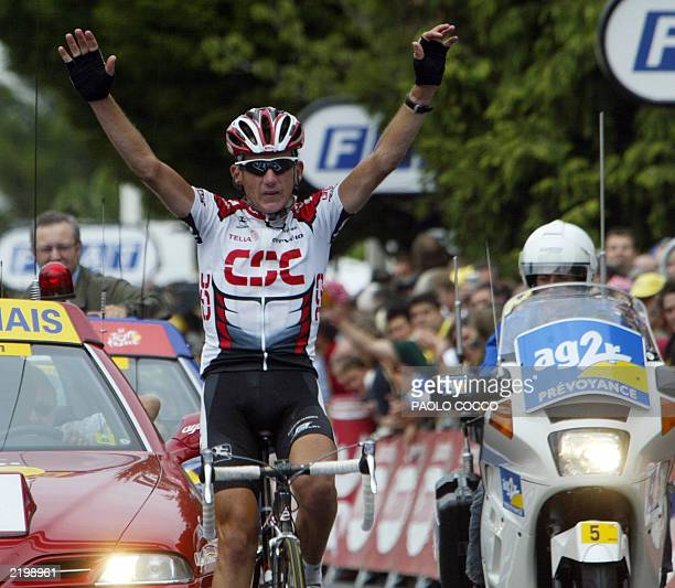 US Tyler Hamilton crosses the finish line and wins the 16th stage of the 90th Tour de France cycling race between Pau and Bayonne 23 July 2003 AFP...