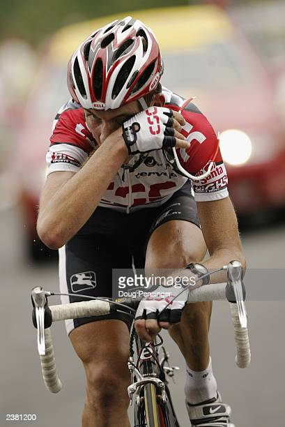 Tyler Hamilton of the United States riding for CSC wipes sweat from his eye during a solo break on stage 16 of the Tour de France from Pau to Bayonne...