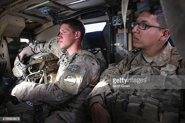 Tyler Hankins from Loves Park Illinoi and PFC Alexander Medina from Keshena Wisconsin with the US Army's 4th squadron 2d Cavalry Regiment sit in the...