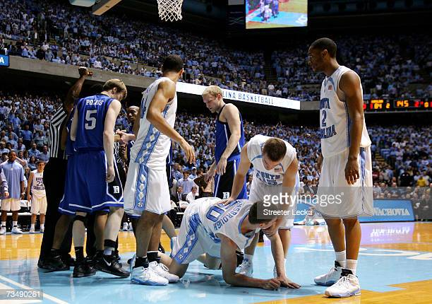 Tyler Hansbrough is helped up by teammate Dewey Burke of the University of North Carolina after Gerald Henderson of the Duke Blue Devils is ejected...