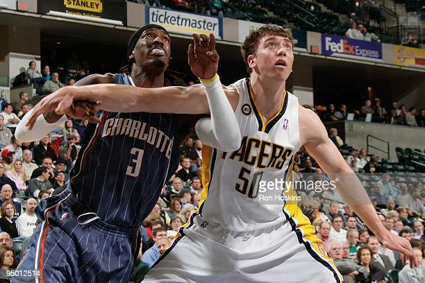 Tyler Hansbrough of the Indiana Pacers boxes out Gerald Wallace of the Charlotte Bobcats during the game on December 16 2009 at Conseco Fieldhouse in...