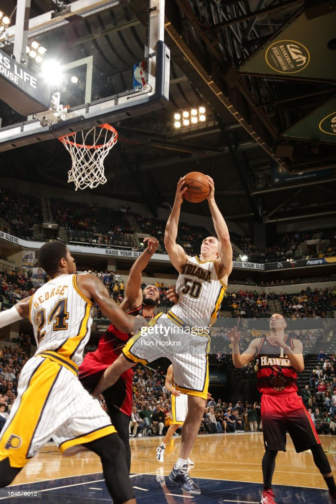 Tyler Hansbrough #50 of the Indiana Pacers rebounds against the Atlanta Hawks on March 25, 2013 at Bankers Life Fieldhouse in Indianapolis, Indiana.