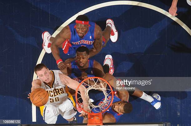 df8f38785332 Tyler Hansbrough of the Indiana Pacers scores over Ben Wallace Rodney  Stuckey and Greg Monroe of