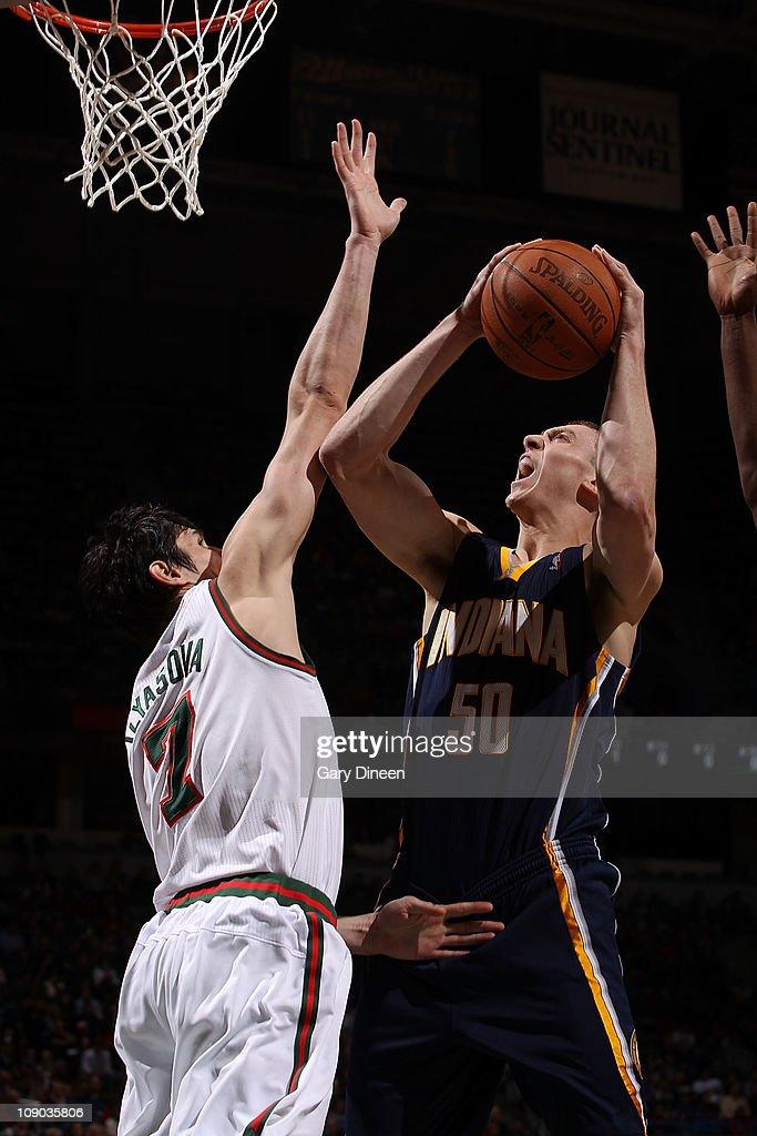 0fedea8b6b7d Tyler Hansbrough  50 of the Indiana Pacers shoots a layup against Ersan  Ilyasova  7