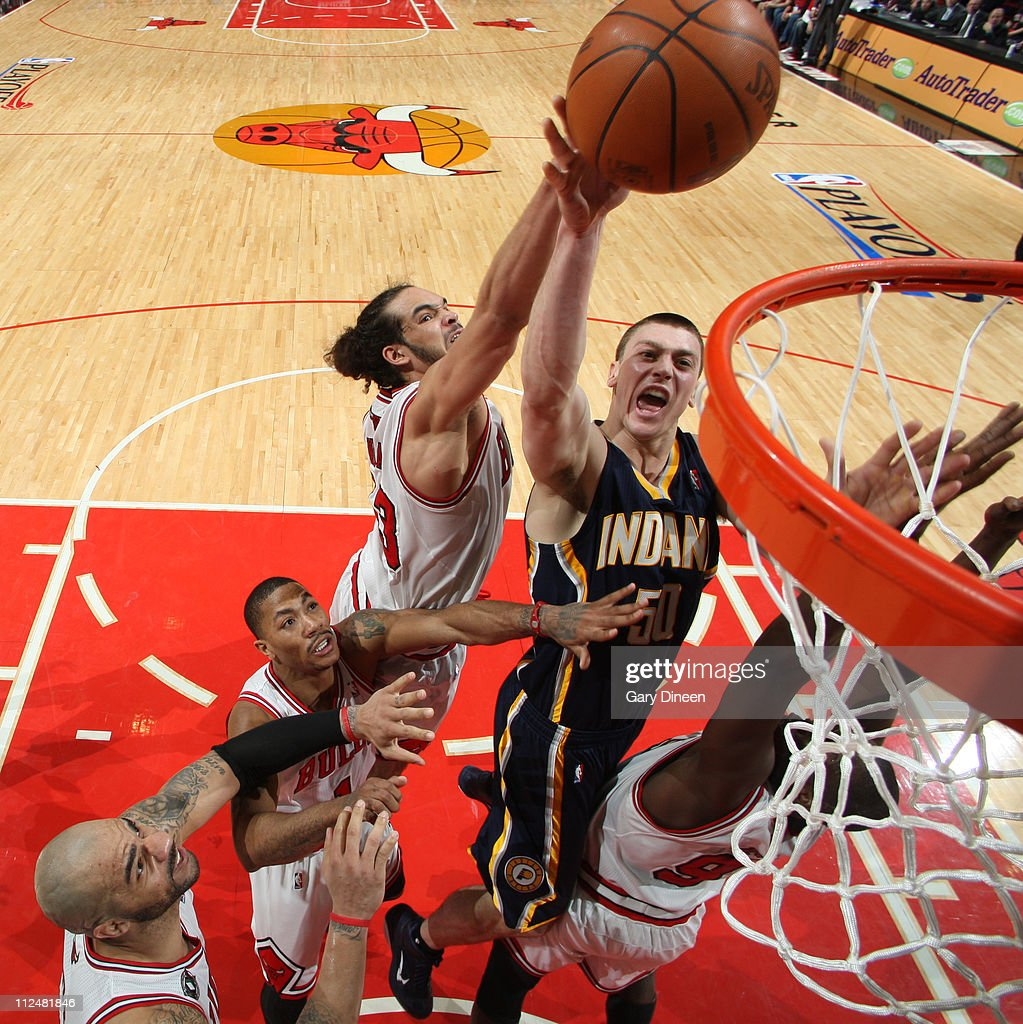 Tyler Hansbrough #50 of the Indiana Pacers shoots against Joakim Noah #13 of the Chicago Bulls in Game Two of the Eastern Conference Quarterfinals in the 2011 NBA Playoffs on April 18, 2011 at the United Center in Chicago, Illinois.
