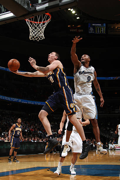 e5da8053dbd4 Tyler Hansbrough  50 of the Indiana Pacers shoots against Rashard Lewis  9  of the