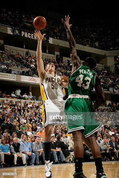 Tyler Hansbrough of the Indiana Pacers shoots over Kendrick Perkins of the Boston Celtics at Conseco Fieldhouse on November 14, 2009 in Indianapolis,...