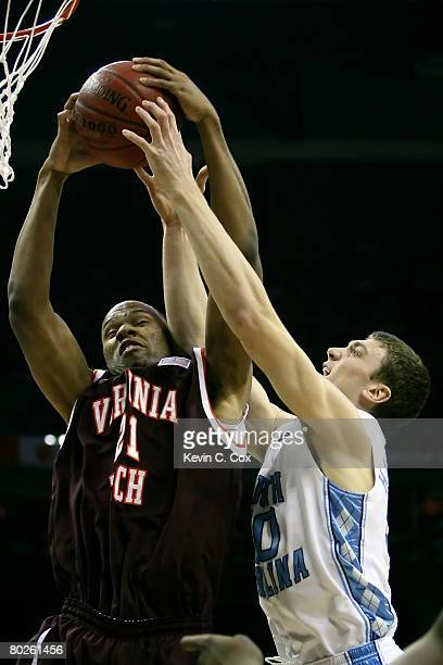 Tyler Hansbrough of the North Carolina Tar Heels and Lewis Witcher of the Virginia Tech Hokies battle for a rebound during the semifinals of the 2008...